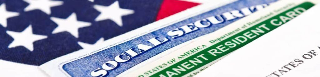 green card, american flag and other documents